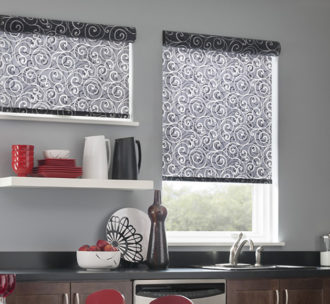 Gray patterned roller shades ahve a pretty design